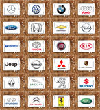 World famous car brands. Collection of the famous car brands logos on white tablet on rusted wooden background. Brands like mercedes , volkswagen , bmw , toyota Stock Photography