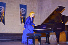 World famous classical pianist Gulsin Onay at a concert in Bellapais Abbey in North Cyprus. Stock Image