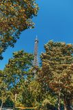 World famous Eiffel tower surrounded by green trees royalty free stock image