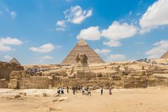 World famous Giza pyramids and the Great Sphinx with tourist royalty free stock photography