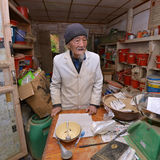 World famous herbal doctor Ho preparing traditional herbal medicine Stock Photos