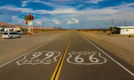 World famous and historic Route 66 signs on road at iconic Roy`s Motel and Cafe in Amboy, California. USA royalty free stock photo