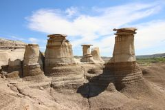 The world famous hoodoos in Drumheller, Alberta. With amazing clouds in the background, the world famous hoodoos in Drumheller, Alberta stand out as remnants of stock images