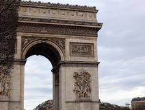World famous landmark Arc de Triomphe in Paris France during sunrise no people in picture. During spring Stock Photos