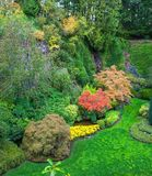 The world-famous masterpiece. Butchart Gardens - beautiful gardens on Vancouver Island. Flower beds of colorful flowers and walking paths for tourists. The world stock photos