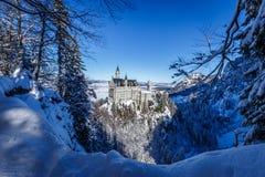 Winter scene at Neuschwanstein Castle royalty free stock photo
