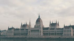 The world famous parliament building in Budapest built in the Gothic in the background of an airplane flying from above. In cloudy weather stock footage