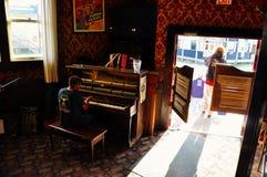 The piano man inside the Downtown Hotel in Dawson City, Yukon. The world famous sour toe challenge takes place inside the Downtown Hotel in Dawson City, Yukon stock photo