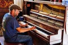 The piano man inside the Downtown Hotel in Dawson City, Yukon. stock photography