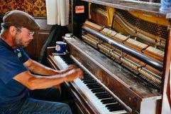 The piano man inside the Downtown Hotel in Dawson City, Yukon. The world famous sour toe challenge takes place inside the Downtown Hotel in Dawson City, Yukon royalty free stock photo