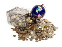 World financial crisis. The globe and is a lot of coins. World financial crisis royalty free stock images