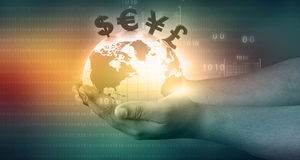 World with  financial symbols. Coming from hand Stock Photo