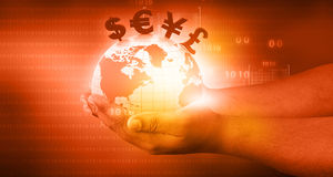 World with  financial symbols. Coming from hand Royalty Free Stock Image