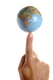 World on a finger tip. Got the world at his finger tips. Hand with the planet earth on a finger tip. White Background. Planet,earth,world,globe,atlas,hand,finger Royalty Free Stock Photography