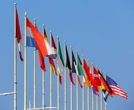 Free World Flags Against Blue Sky Royalty Free Stock Image - 123323756