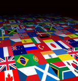 World Flags Background. With the symbols of countries from  the globe in forced perspective fading to black as an icon of international business or Stock Photos