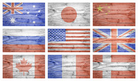 World flags collage over wood planks texture. World flags collage over natural wood planks texture Royalty Free Stock Photography