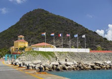 World flags infront of Dr. Wathey Pier. Philipsburg Royalty Free Stock Image