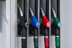 Fuel gas pistols gas station royalty free stock image