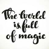 The world is full of magic calligraphic inscription Royalty Free Stock Photo