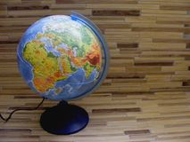 World Geographical Globe On The Wooden Table stock photos