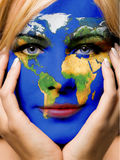 World girl. Girl with world map painted on her face royalty free stock photo