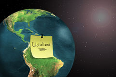 World globalization. Sticky note on earth showing world globalization Royalty Free Stock Image