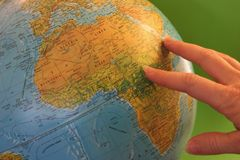 World Globe. Hand pointing at world globe stock photo