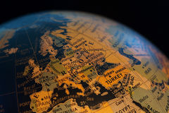 World Globe. Close up view of a world globe against black stock image