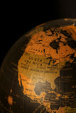 World Globe. Close up view of a world globe against black stock photo