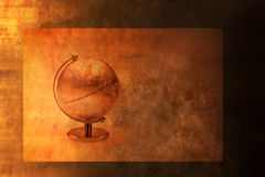 World Globe Background. A world globe on a warm toned abstract background with texture and gradation Royalty Free Stock Images