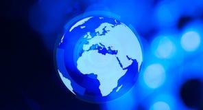 World globe background. World globe and blue defocused background Stock Photos