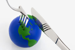 World globe ball with fork and knife Stock Image