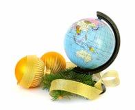World globe and christmas decoration stock photography