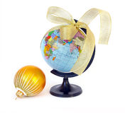 World globe and christmas sphere Royalty Free Stock Photos