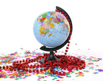 World globe and colorful confetti Royalty Free Stock Photos