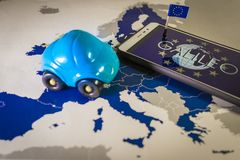 World globe and EU flag inside a smartphone and EU map, Galileo system metaphor. Galileo word in smartphone and car toy over a EU map,symbolizing the European Royalty Free Stock Images