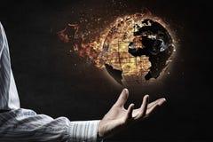 World globe in fire . Mixed media Royalty Free Stock Image