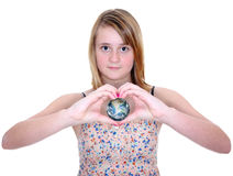 World globe in hands. Planet Earth world globe in love heart shaped girls hands on white stock photography