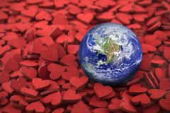 World globe on hundreds of small red hearts royalty free stock images