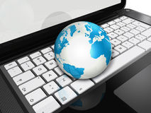 World globe on a laptop computer Stock Photos