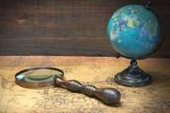 World Globe  And Magnifier On The Old Map Stock Photography