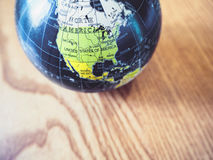 World Globe Map close up United state of America. On wooden background stock photo