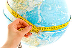 World globe and measuring tape Royalty Free Stock Images