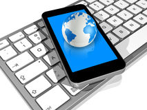 World globe, mobile phone, computer keyboard Royalty Free Stock Photos