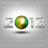 World Globe New Year 2013. New Year Illustration: A golden globe with shiny silver number 2013 on a light grey background with New Year greetings in different stock illustration