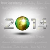World Globe New Year 2014. New Year Illustration: A golden globe with shiny silver number 2014 on a light grey background with New Year greetings in different Royalty Free Stock Image