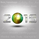 World Globe New Year 2015. New Year Illustration: A golden globe with shiny silver number 2015 on a light grey background with New Year greetings in different Stock Photo