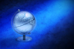 World Globe North America. A blue metallic world globe showing North America on an abstract blue background Stock Image