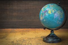 World Globe On The Old Map Stock Photo